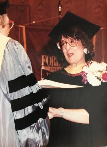 Carolyn Pagani accepting her Fordham diploma