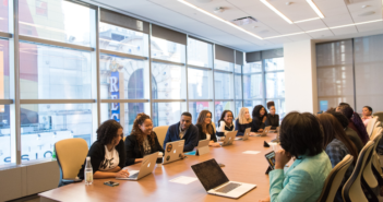 People of color sitting around a conference table