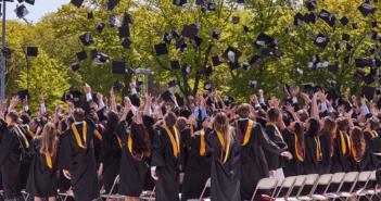 Graduates throwing caps into the air